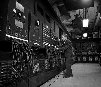 The ENIAC computer with its co-inventor, John W. Mauchly. Source: Bettmann/Corbis