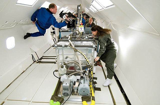 "A 3D printer, the EFB3 (Electron Beam Freeform Fabrication) is seen here being tested on the ""vomit comet,"" the NASA airplane that creates microgravity conditions in parabolic flight.   Source: ZMEScience.com"