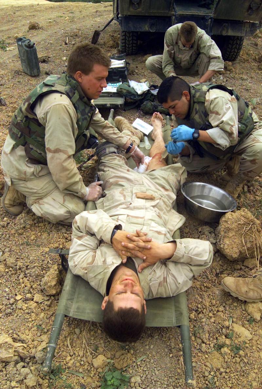 MED_Corpsman_Treats_Marine_Near_Baghdad_Iraq_lg